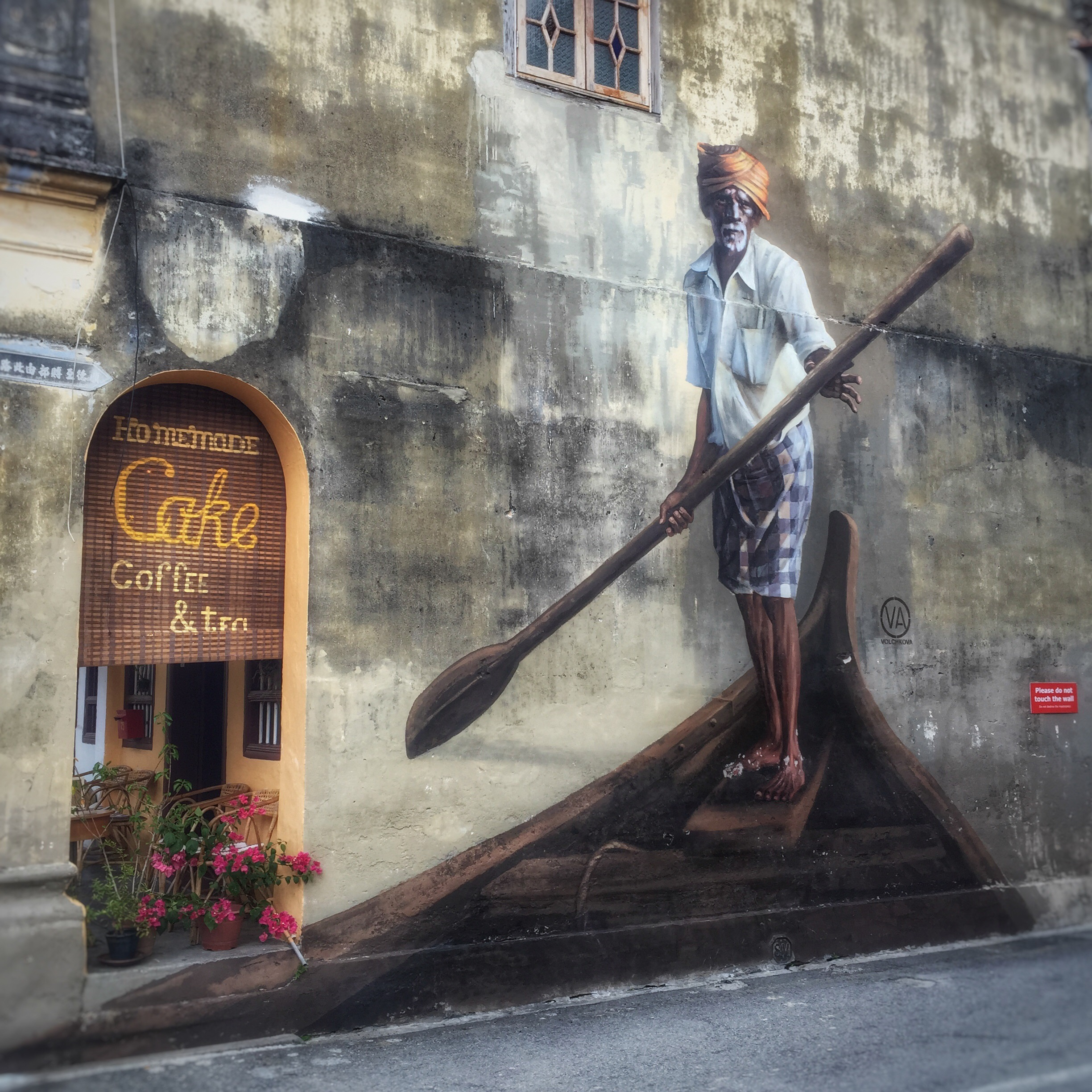 pengang street art -  man with boat